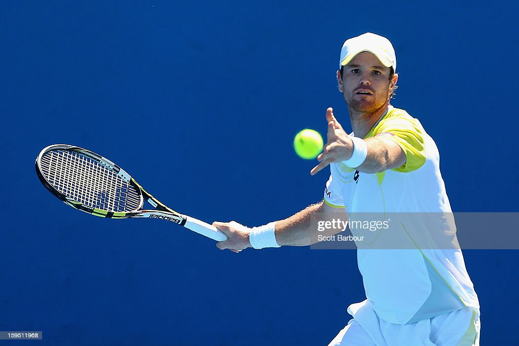 <a gi-track='captionPersonalityLinkClicked' href=/galleries/search?phrase=Blaz+Kavcic&family=editorial&specificpeople=7023045 ng-click='$event.stopPropagation()'>Blaz Kavcic</a> of Slovenia plays a forehand in his first round match against Thomas Bellucci of Brazil during day two of the 2013 Australian Open at Melbourne Park on January 15, 2013 in Melbourne, Australia.