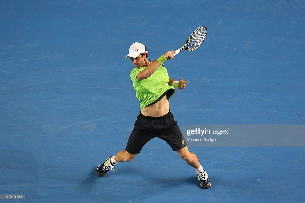 <a gi-track='captionPersonalityLinkClicked' href=/galleries/search?phrase=Blaz+Kavcic&family=editorial&specificpeople=7023045 ng-click='$event.stopPropagation()'>Blaz Kavcic</a> of Slovenia plays a forehand in his second round match against Roger Federer of Switzerland during day four of the 2014 Australian Open at Melbourne Park on January 16, 2014 in Melbourne, Australia.