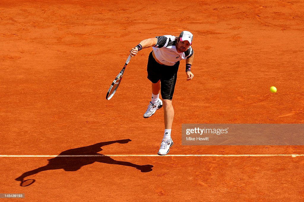 <a gi-track='captionPersonalityLinkClicked' href=/galleries/search?phrase=Blaz+Kavcic&family=editorial&specificpeople=7023045 ng-click='$event.stopPropagation()'>Blaz Kavcic</a> of Slovenia serves in his men's singles second round match against <a gi-track='captionPersonalityLinkClicked' href=/galleries/search?phrase=Blaz+Kavcic&family=editorial&specificpeople=7023045 ng-click='$event.stopPropagation()'>Blaz Kavcic</a> of Slovenia during day 4 of the French Open at Roland Garros on May 30, 2012 in Paris, France.