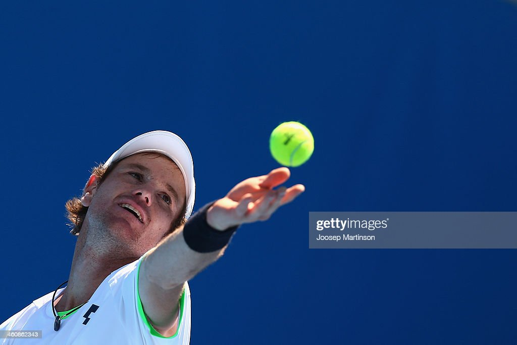<a gi-track='captionPersonalityLinkClicked' href=/galleries/search?phrase=Blaz+Kavcic&family=editorial&specificpeople=7023045 ng-click='$event.stopPropagation()'>Blaz Kavcic</a> of Slovenia serves in his qualifying match against Albert Ramos of Spain during day two of the Sydney International at Sydney Olympic Park Tennis Centre on January 6, 2014 in Sydney, Australia.