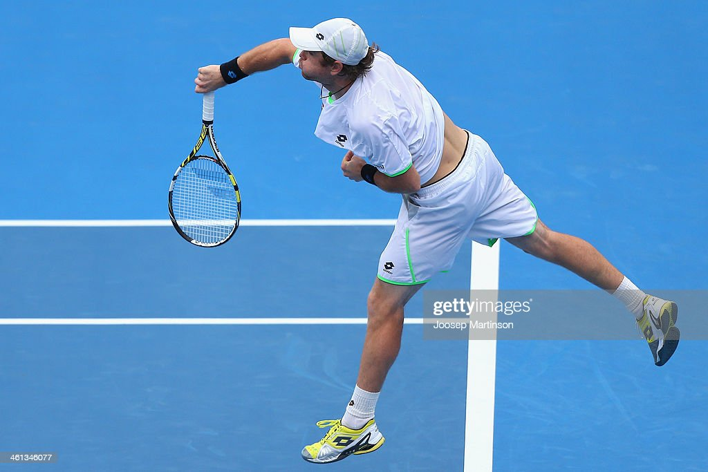 <a gi-track='captionPersonalityLinkClicked' href=/galleries/search?phrase=Blaz+Kavcic&family=editorial&specificpeople=7023045 ng-click='$event.stopPropagation()'>Blaz Kavcic</a> of Slovenia serves in his quarter final match against Bernard Tomic of Australia during day four of the 2014 Sydney International at Sydney Olympic Park Tennis Centre on January 8, 2014 in Sydney, Australia.