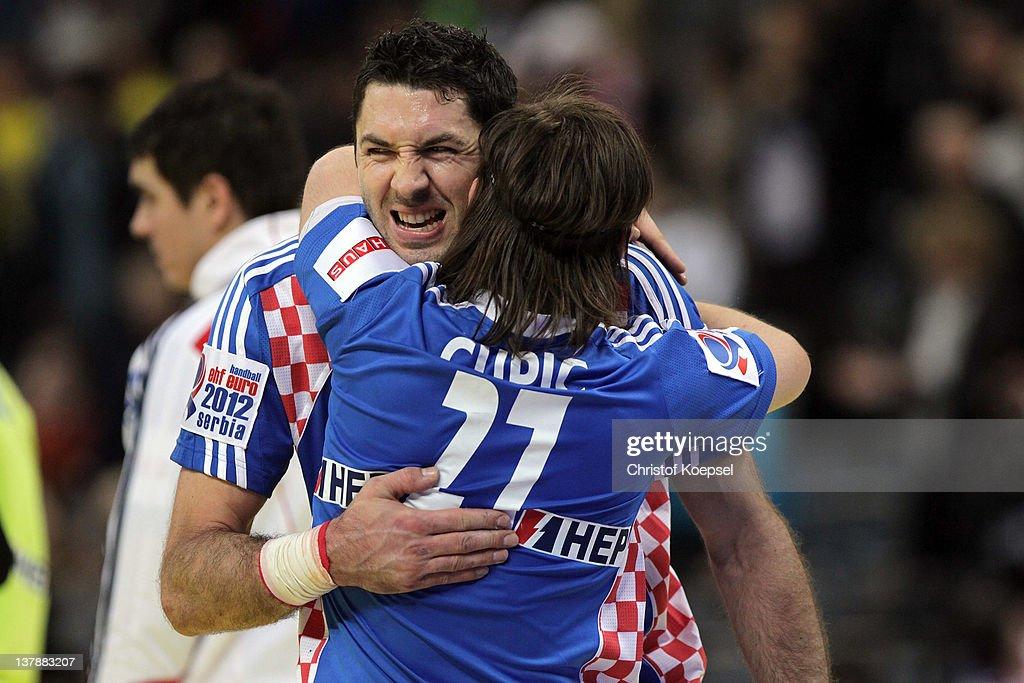 Blazenko Lackovic embraces Ivan Cupic of Croatia after the Men's European Handball Championship bronze medal match between Croatia and Spain at...