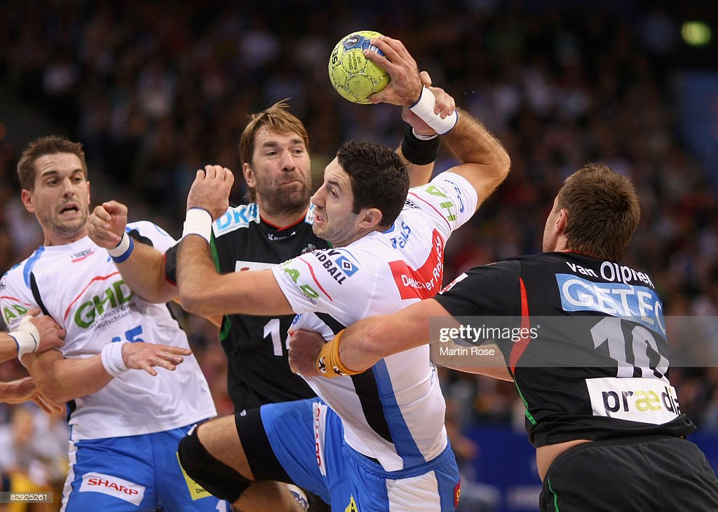 Blazenko Lackovic (C) of Hamburg is attacked by Steffen Stiebler and Fabian van Olphen (#10) of Magdeburg during the Bundesliga match between HSV Hamburg and SC Magdeburg at the Color Line Arena on September 20, 2008 in Hamburg, Germany.