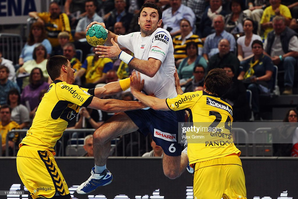 <a gi-track='captionPersonalityLinkClicked' href=/galleries/search?phrase=Blazenko+Lackovic&family=editorial&specificpeople=663011 ng-click='$event.stopPropagation()'>Blazenko Lackovic</a> (C) of Hamburg is challenged by Zarko Sesum (L) and Patrick Groetzki of Rhein-Neckar Loewen during the Toyota Handball Bundesliga match between Rhein Neckar Loewen and HSV Hamburg at SAP Arena on May 3, 2011 in Mannheim, Germany.