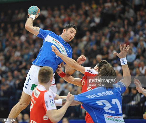 Blazenko Lackovic of Hamburg throws a goal during the DKB Bundesliga handball game between HSV Hamburg and TUSEM Essen at O2 World on April 17 2013...