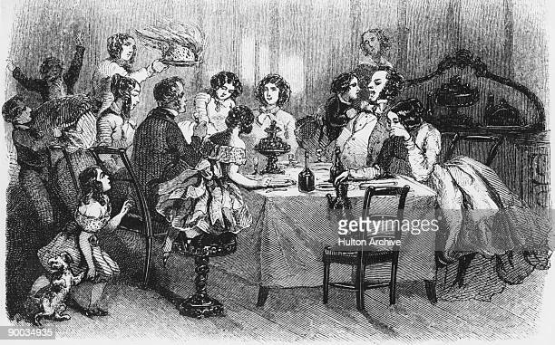 A blazing plum pudding is served at a family Christmas dinner circa 1860