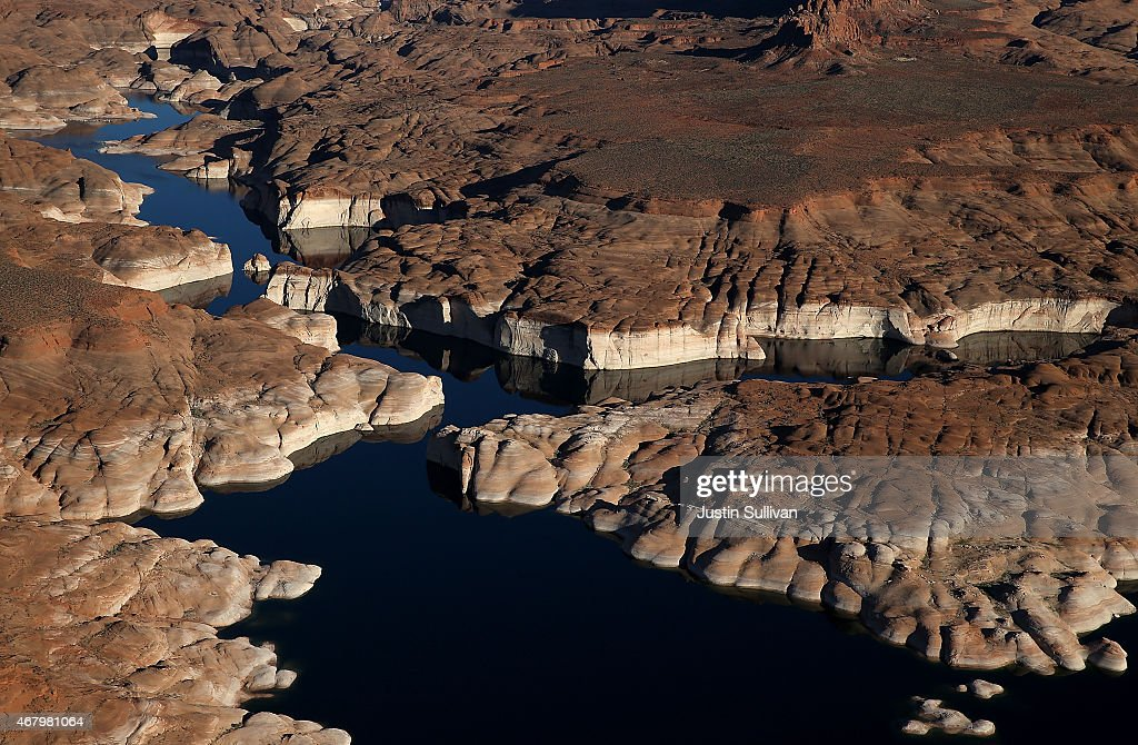 A bleached 'bathtub ring' is visible on the rocky banks of Lake Powell on March 28 2015 in Lake Powell Utah As severe drought grips parts of the...