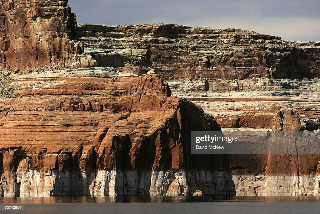 A bleached 'bathtub ring', the result of a six-year drought that has dramatically dropped the level of the reservoir, shows on red Navajo sandstone formations near Last Chance Bay at Lake Powell on March 26, 2007 near Page, Arizona. Lake Powell and the next biggest Colorado River reservoir, the nearly 100-year-old Lake Mead, are at the lowest levels ever recorded. Environmentalists have long-lamented the damming of scenic Glen Canyon, the eastern sibling of the Grand Canyon, in the early 1960's to create the 186-mile-long Lake Powell. The US Bureau of Reclamation is evaluating four proposals to manage the drought on the Colorado River which supplies water and power to millions of people in the western states. The bureau has warned that shortages are possible as early as 2010. If the water drops too far, power generators at the dams will become inoperable.