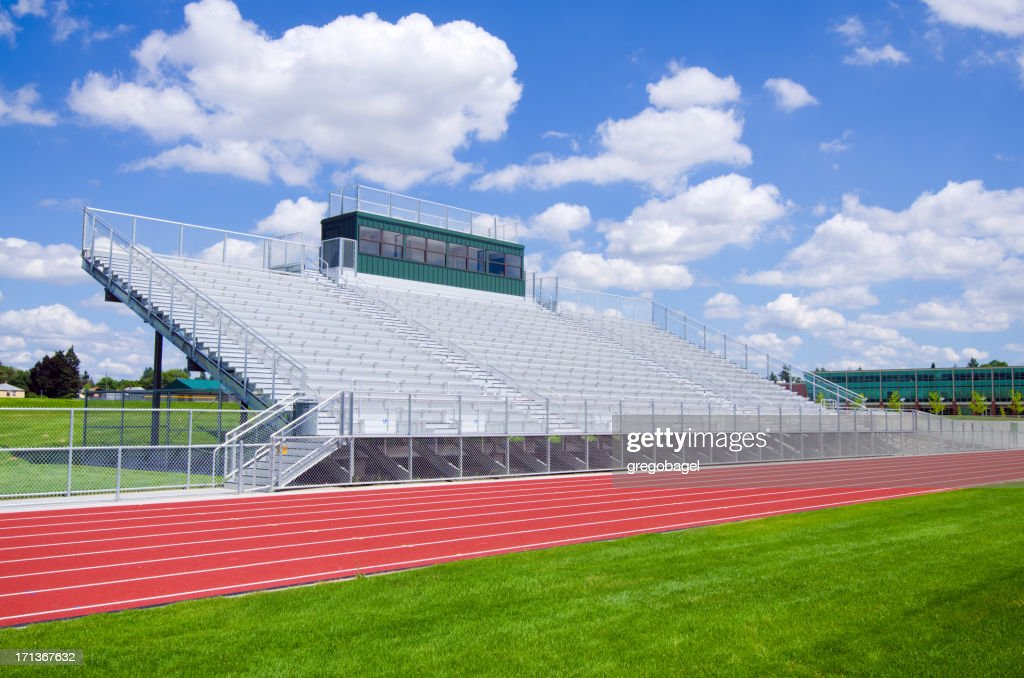 Bleachers at a high school football field with track
