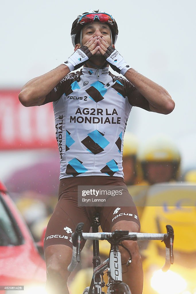 Blel Kadri of France and AG2R La Mondiale celebrates crossing the finish line and winning the eighth stage of the 2014 Tour de France a 161km stage...