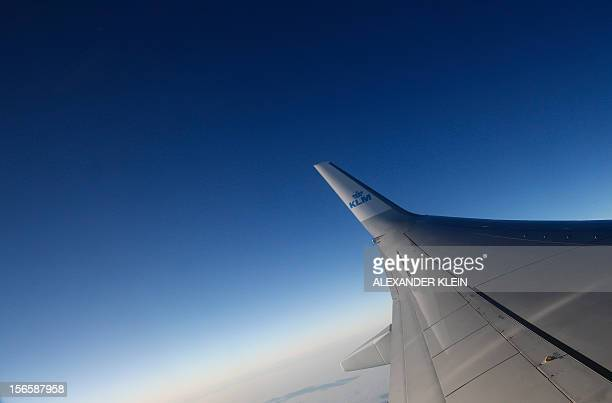 A blended winglet is seen on the left wing of a Boeing 737 airplane of Dutch airline company KLM near Vienna Schwechat international airport some...