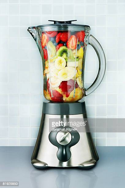 Blender packed with fruit