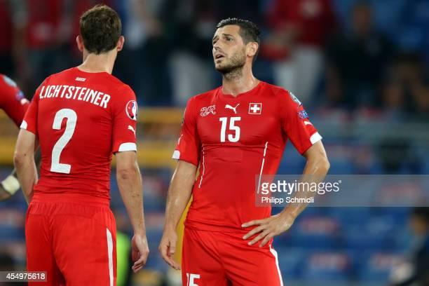 Blerim Dzemaili and Stephan Lichtsteiner of Switzerland look dejected after loosing the EURO 2016 Qualifier match between Switzerland and England on...