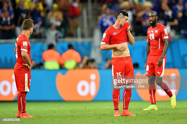 Blerim Dzemaili and Xherdan Shaqiri of Switzerland show their dejection after conceding fifth goal to France during the 2014 FIFA World Cup Brazil...