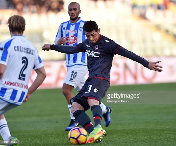 Blerim Dzemaili of Bologna FC scores the goal 02 during the Serie A match between Pescara Calcio and Bologna FC at Adriatico Stadium on December 18...