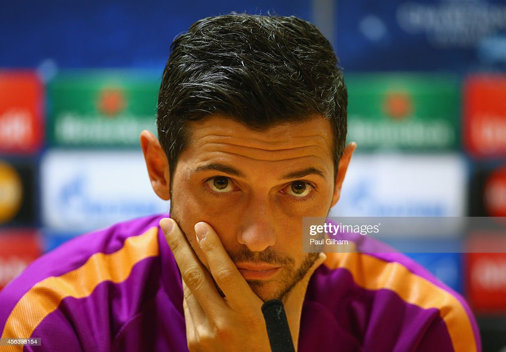 Blerim Dzemaili of Galatasaray talks to the media ahead of a Galatasaray training session ahead of their UEFA Champions League Group D match against Arsenal at Emirates Stadium on September 30, 2014 in London, United Kingdom.
