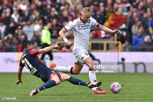 Blerim Dzemaili of Genoa CFC tackles Kamil Glik of Torino FC during the Serie A match between Genoa CFC and Torino FC at Stadio Luigi Ferraris on...