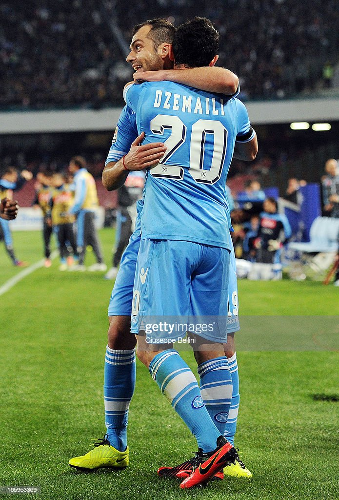 Blerim Dzemaili of Napoli (R) celebrates after scoring their team's second goal during the Serie A match between SSC Napoli and Genoa CFC at Stadio San Paolo on April 7, 2013 in Naples, Italy.