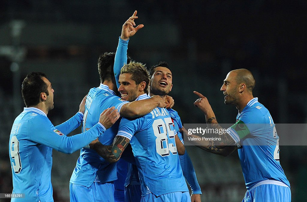 Blerim Dzemaili (C) of SSC Napoli celebrates with team-mates after scoring his third goal during the Serie A match between Torino FC and SSC Napoli at Stadio Olimpico di Torino on March 30, 2013 in Turin, Italy.