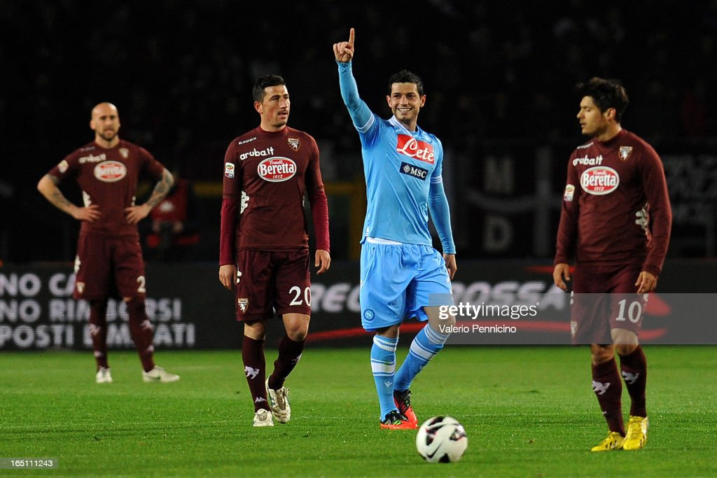 Blerim Dzemaili (C) of SSC Napoli scoring celebrates the opening goal during the Serie A match between Torino FC and SSC Napoli at Stadio Olimpico di Torino on March 30, 2013 in Turin, Italy.