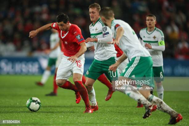 Blerim Dzemaili of Switzerland and George Saville of Northern Ireland during the FIFA 2018 World Cup Qualifier PlayOff Second Leg between Switzerland...