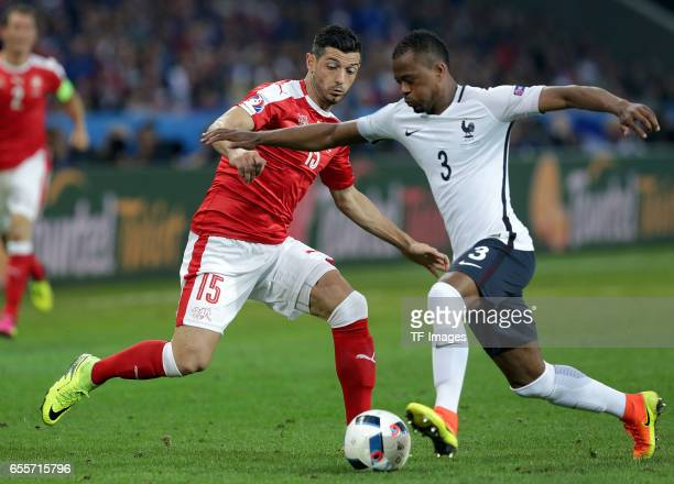 Blerim Dzemaili of Switzerland and Patrice Evra of France battle for the ball during the UEFA Euro 2016 Group A match between the Switzerland and...