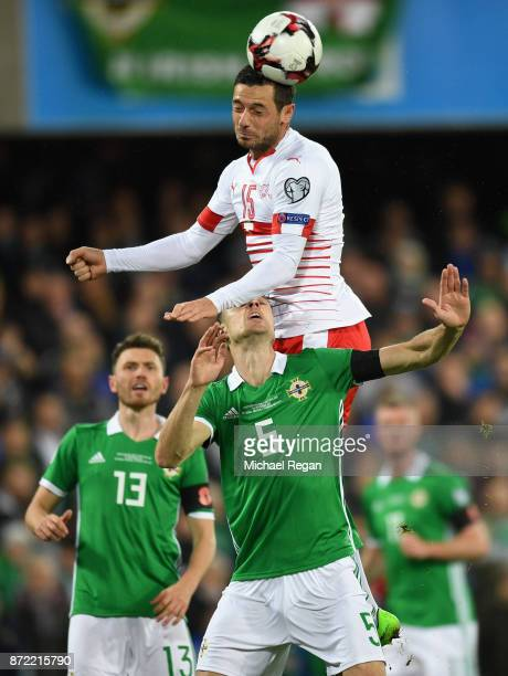 Blerim Dzemaili of Switzerland climbs over the top of Jonny Evans of Northern Ireland to win a header during the FIFA 2018 World Cup Qualifier...