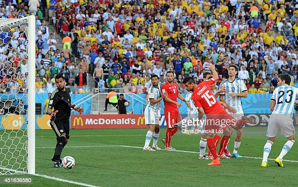 Blerim Dzemaili of Switzerland heads against the post during the 2014 FIFA World Cup Brazil Round of 16 match between Argentina and Switzerland at...