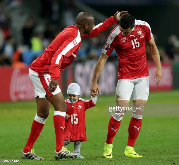 Blerim Dzemaili of Switzerland laeuft and Gelson Fernandes of Switzerland celebrate their win during the UEFA Euro 2016 Group A match between the...