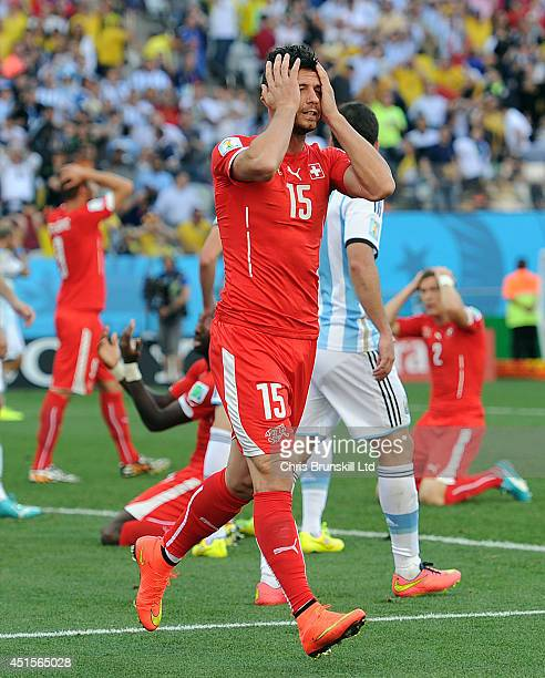 Blerim Dzemaili of Switzerland looks dejected during the 2014 FIFA World Cup Brazil Round of 16 match between Argentina and Switzerland at Arena de...