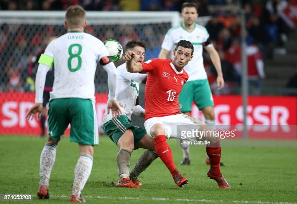 Blerim Dzemaili of Switzerland Oliver Norwood of Northern Ireland during the FIFA 2018 World Cup Qualifier PlayOff Second Leg between Switzerland and...
