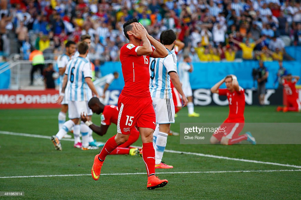 Blerim Dzemaili of Switzerland reacts after a missed chance at goal during the 2014 FIFA World Cup Brazil Round of 16 match between Argentina and Switzerland at Arena de Sao Paulo on July 1, 2014 in Sao Paulo, Brazil.