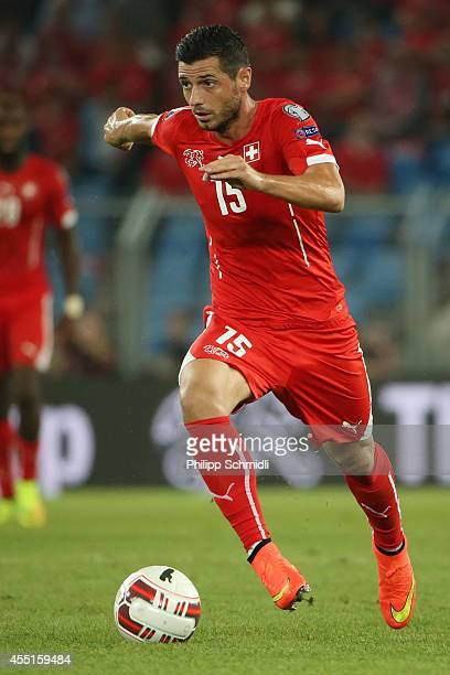 Blerim Dzemaili of Switzerland runs with the ball during the EURO 2016 Qualifier match between Switzerland and England on September 8 2014 in Basel...