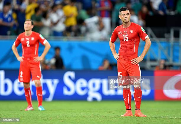 Blerim Dzemaili of Switzerland shows their dejection after conceding fifth goal to France during the 2014 FIFA World Cup Brazil Group E match between...