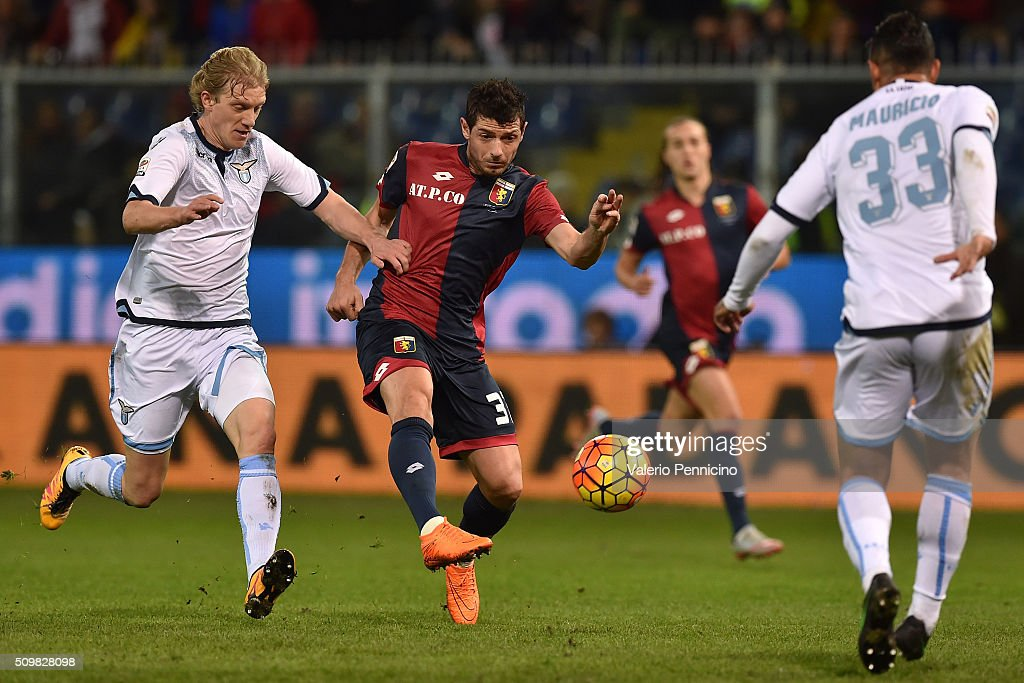 Blerin Dzemaili (C) of Genoa CFC is challenged by Dusan Basta (L) of SS Lazio during the Serie A match between Genoa CFC and SS Lazio at Stadio Luigi Ferraris on February 6, 2016 in Genoa, Italy.