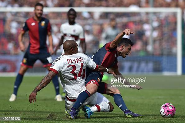 Blerin Dzemaili of Genoa CFC is tackled by Nigel De Jong of AC Milan during the Serie A match between Genoa CFC and AC Milan at Stadio Luigi Ferraris...