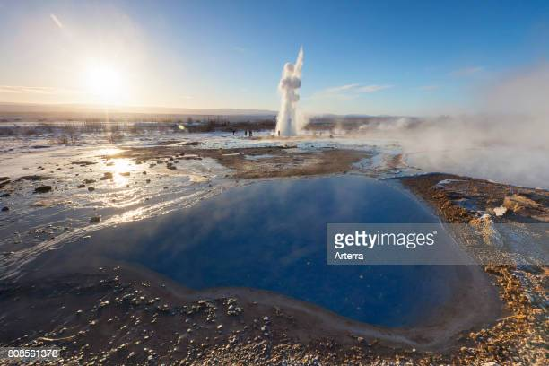 Blesi hot spring pool and Geyser Strokkur fountain geyser in the geothermal area beside the Hv't‡ River Haukadalur Sudurland Iceland