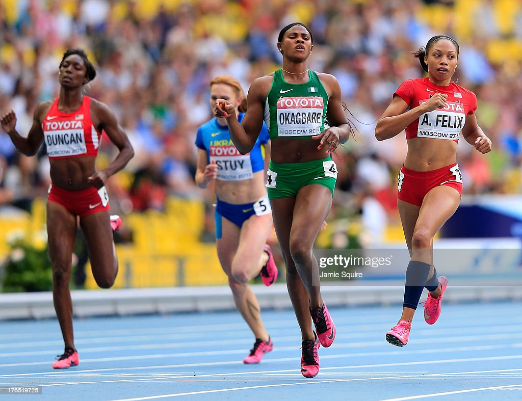 Blessing Okagbare of Nigeria and Allyson Felix of the United States compete in the Women's 200 metres semi finals during Day Six of the 14th IAAF World Athletics Championships Moscow 2013 at Luzhniki Stadium on August 15, 2013 in Moscow, Russia.