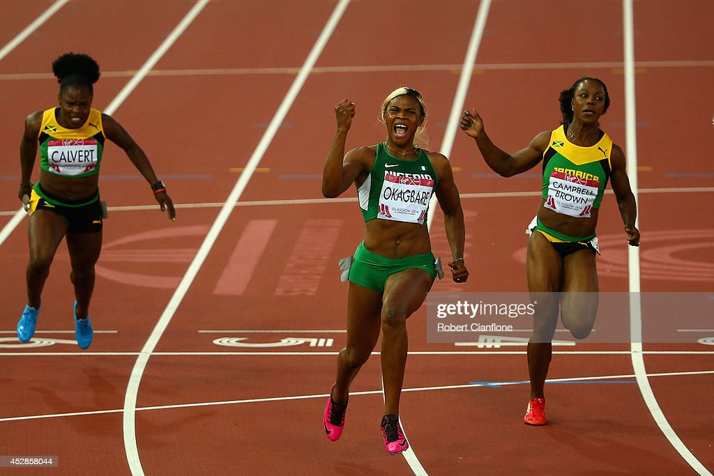 <a gi-track='captionPersonalityLinkClicked' href=/galleries/search?phrase=Blessing+Okagbare&family=editorial&specificpeople=5496695 ng-click='$event.stopPropagation()'>Blessing Okagbare</a> of Nigeria (C) crosses the line to win gold ahead of silver medalist <a gi-track='captionPersonalityLinkClicked' href=/galleries/search?phrase=Veronica+Campbell-Brown&family=editorial&specificpeople=4861760 ng-click='$event.stopPropagation()'>Veronica Campbell-Brown</a> of Jamaica (R) in the Women's 100 metres final at Hampden Park during day five of the Glasgow 2014 Commonwealth Games on July 28, 2014 in Glasgow, United Kingdom.