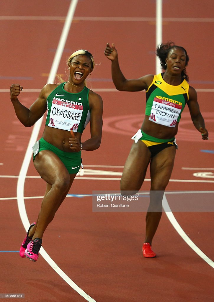 <a gi-track='captionPersonalityLinkClicked' href=/galleries/search?phrase=Blessing+Okagbare&family=editorial&specificpeople=5496695 ng-click='$event.stopPropagation()'>Blessing Okagbare</a> of Nigeria (L) crosses the line to win gold ahead of silver medalist <a gi-track='captionPersonalityLinkClicked' href=/galleries/search?phrase=Veronica+Campbell-Brown&family=editorial&specificpeople=4861760 ng-click='$event.stopPropagation()'>Veronica Campbell-Brown</a> of Jamaica (R) in the Women's 100 metres final at Hampden Park during day five of the Glasgow 2014 Commonwealth Games on July 28, 2014 in Glasgow, United Kingdom.