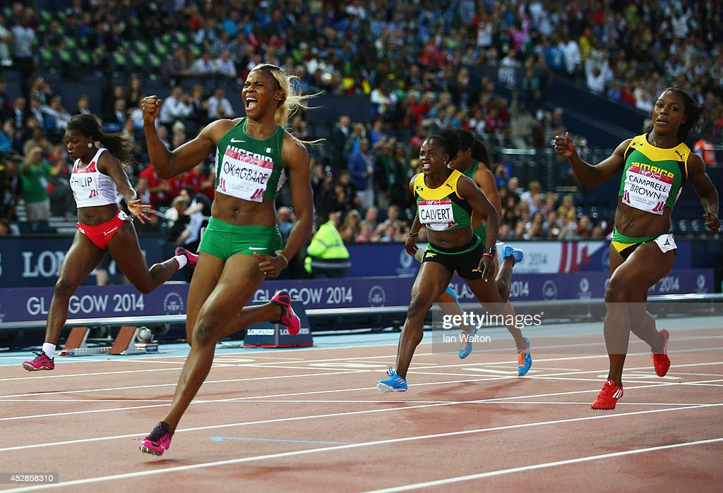 <a gi-track='captionPersonalityLinkClicked' href=/galleries/search?phrase=Blessing+Okagbare&family=editorial&specificpeople=5496695 ng-click='$event.stopPropagation()'>Blessing Okagbare</a> of Nigeria crosses the line to win gold ahead of silver medalist <a gi-track='captionPersonalityLinkClicked' href=/galleries/search?phrase=Veronica+Campbell-Brown&family=editorial&specificpeople=4861760 ng-click='$event.stopPropagation()'>Veronica Campbell-Brown</a> of Jamaic\ in the Women's 100 metres final at Hampden Park during day five of the Glasgow 2014 Commonwealth Games on July 28, 2014 in Glasgow, United Kingdom.