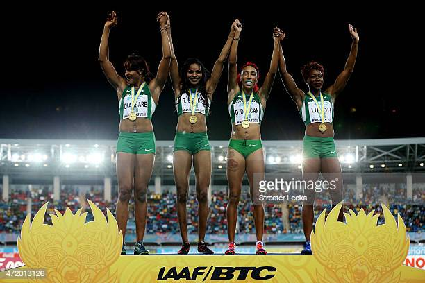 Blessing Okagbare Regina George Dominiue Duncan and Christy Udoh of Nigeria celebrat on the podium after winning the final of the women's of the 4 x...