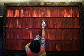 Blessings are pinned to a wall inside the Joss House Bay Tin Hau temple during celebrations for the Tin Hau Festival in Hong Kong on April 29 2016...