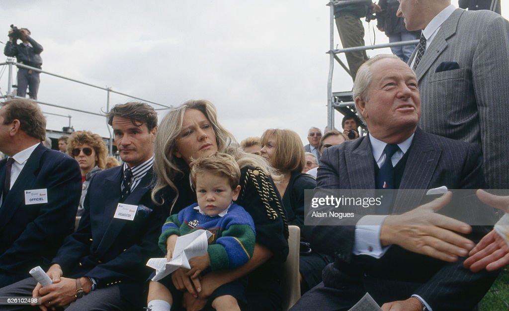 """""""Bleu, blanc rouge"""" celebration of the French far right-wing and nationalist politician, founder and President of the National Front (Front National - FN) Jean-Marie Le Pen. Jean-Marie Le Pen participating at the """"Bleu, blanc rouge"""" celebration with his daughter Marie-Caroline holding her son Quentin Gendron, and sitting next to her husband Jean-Pierre Gendron, Paris, France, 1st October 1989."""