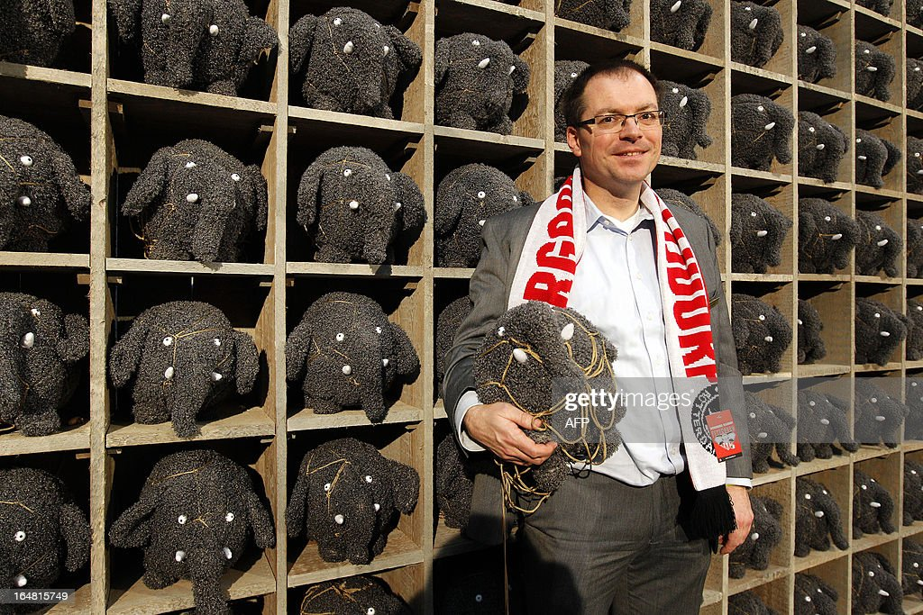 Blijdorp Zoo director Marc Damen poses in front of a scaffolding with stuffed puppets representing elephants called Olli in Rotterdam, The Netherlands, on March 28, 2013. Olli, together with former Feyenoord Rotterdam football player Giovanni van Bronckhorst, stars in a popular Dutch TV commercial about Blijdorp recently becoming the jersey sponsor of the Rotterdam club. netherlands out