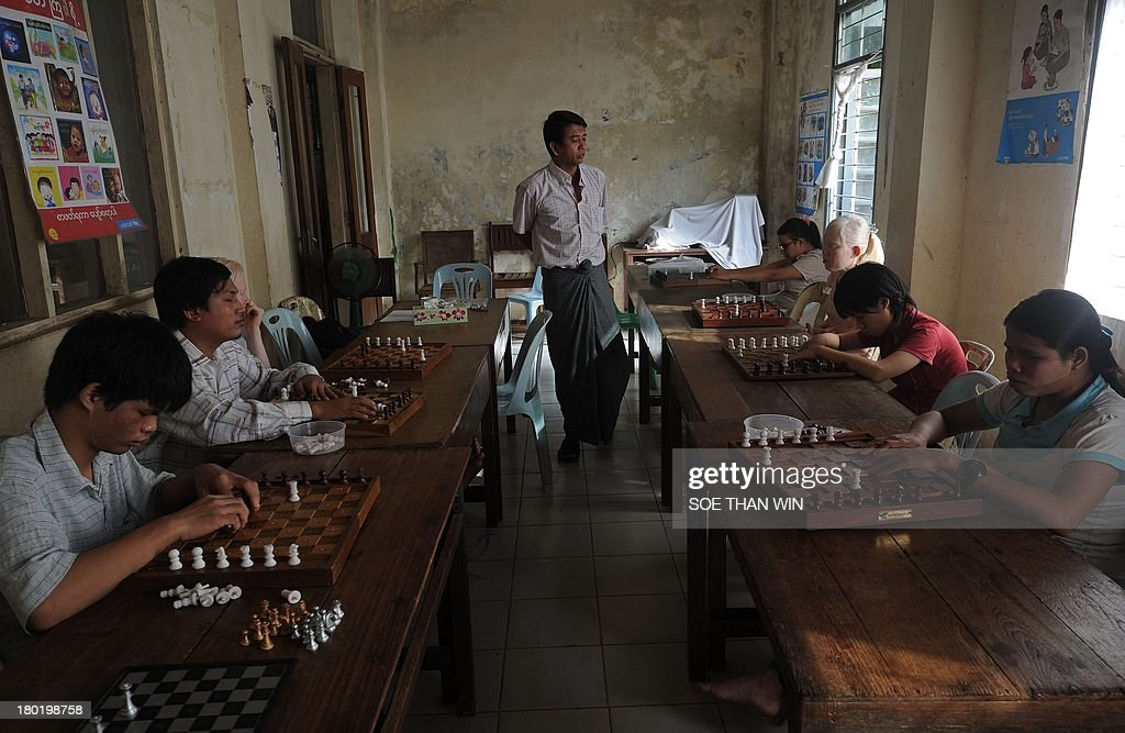 Blind and visually-impaired students learn chess at the Yangon Education Centre for the Blind (Khaweichan) in Yangon on September 10, 2013. The Khaweichan School opened in 1983 and today provides education to 143 blind or visually-impaired students, aged between 5 and 25, from primary to university level. AFP PHOTO/Soe Than WIN