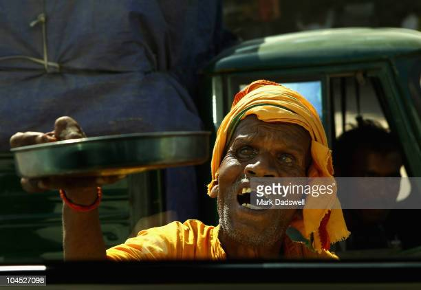 A blind beggar appeals for money on the streets of Delhi India