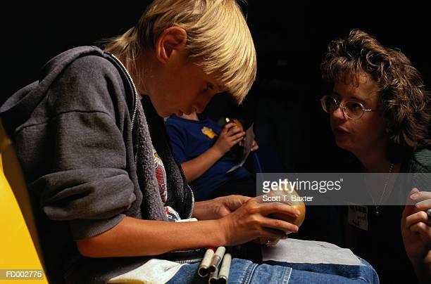 Blind Boy Wrapping Caramel Apple