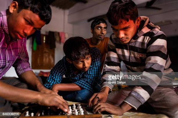 Blind boys play chess in their dorm room in the hostel residence of the Vivekananda Mission Asram school for the blind The game requires...