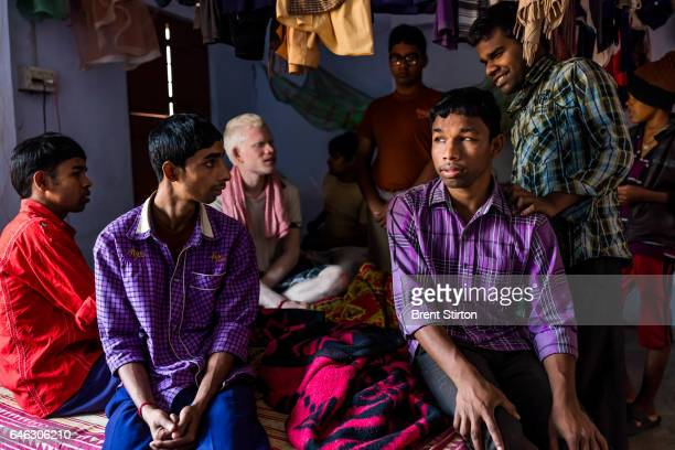 Blind boys talk amongst themselves inside their dorm room in the hostel residence of the Vivekananda Mission Asram school for the blind This is the...